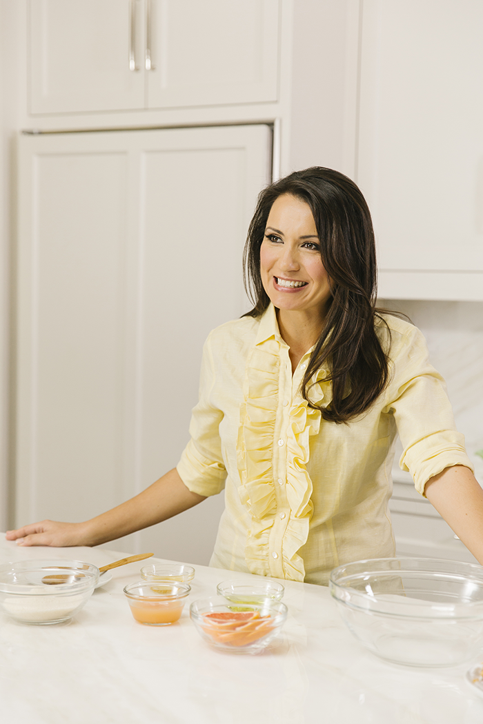 Moms with Style KSW | Kimberly Schlegel Whitman by popular Michigan life and style blog, The HSS Feed: image of Kimberly Schlegel Whitman wearing a light yellow ruffle blouse.