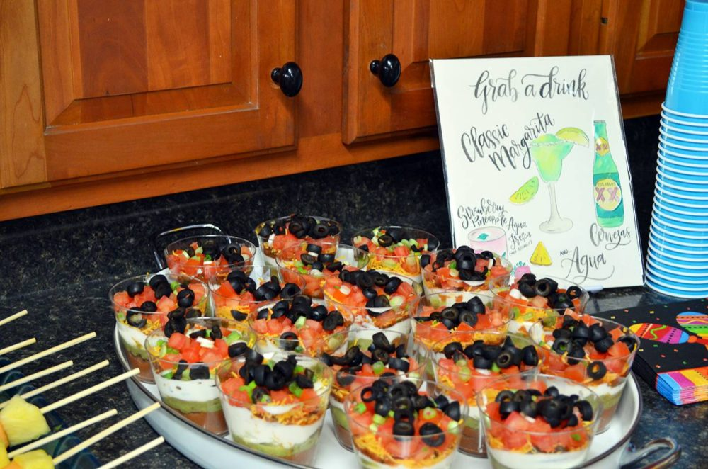 Fiesta Birthday Party by popular Michigan lifestyle blog, The HSS FEED: image of a 7 layer dip cups.