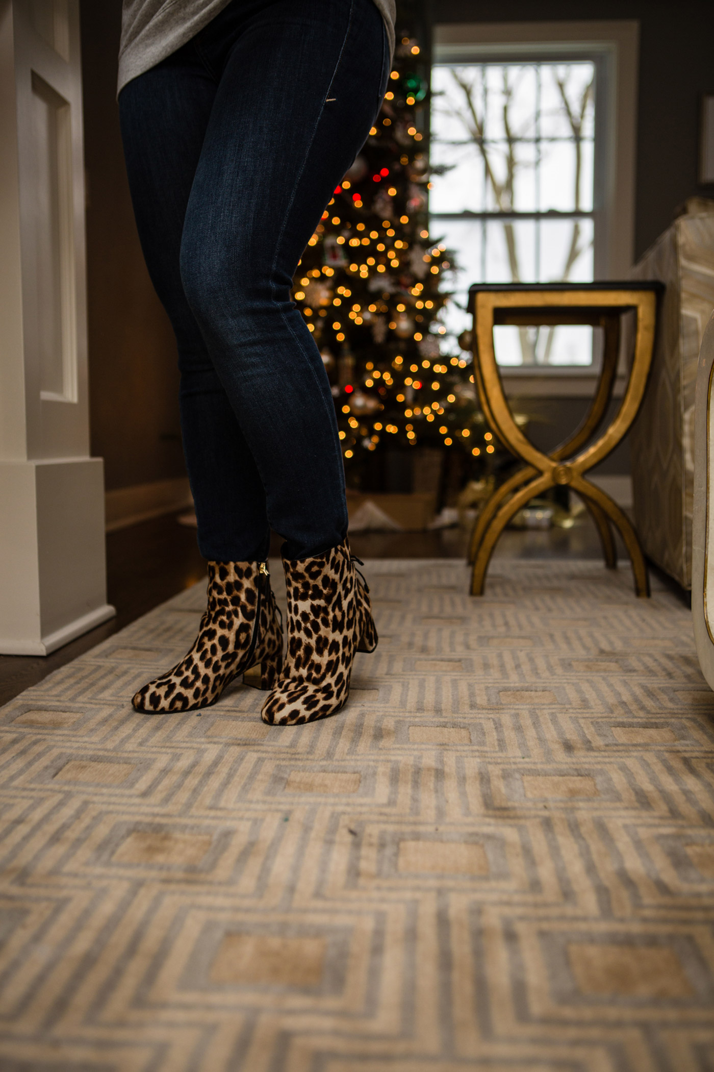 Lisi Lerch Earrings by popular Michigan fashion blog, The HSS Feed: image of a woman wearing leopard print ankle boots.