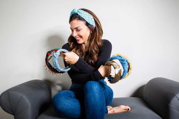 Cute Fall Hair Accessories featured by top US life and style blog, The HSS Feed: image of a woman holding headbands