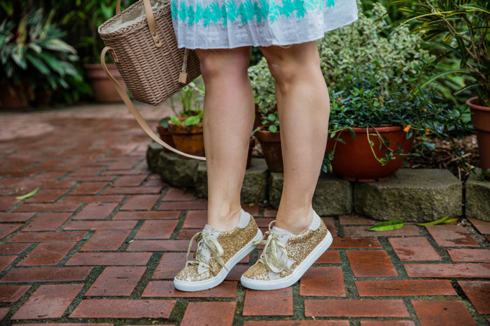 sail to sable casual dress and sneakers | Sail to Sable Features Warm Weather Winter Vacation Outfits For Moms by popular Michigan fashion blog, The HSS Feed: image of a woman wearing a Sail to Sable EMBROIDERED LONG SLEEVE DRESS WHITE OR SKY, Buru Star Gaze Glitter Sneakers Gold, and Kendra Scott Avi Hoop Earrings In Gold.