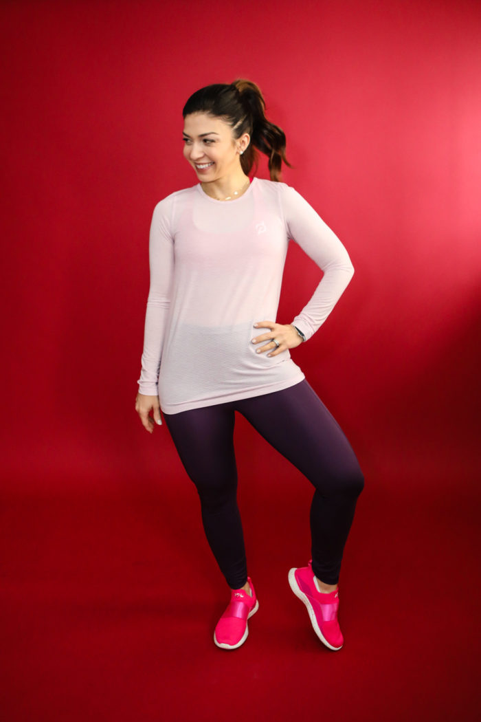 "casual valentine's day outfits athleisure | 3 Casual Valentine's Day Outfits by popular Michigan life and style blog, The HSS Feed: image of a woman wearing a Target Women's Long Sleeve Open Back T-Shirt, Target Women's Contour Power Waist High-Rise 7/8 Leggings with Stash Pocket 25"", Lululemon Energy Bra Medium Support, B/C Cup, Etsy Hello Gorgeous Starbucks Cup, and APL Women's TechLoom Bliss."