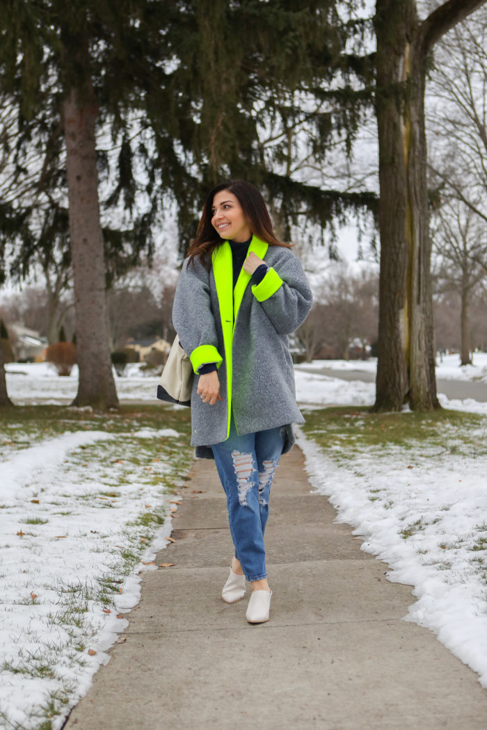dudley stephens capsule collection | Why I Love Dudley Stephens by popular Michigan fashion blog, The HSS Feed: image of a woman wearing a Dudley Stephens Neon Yellow Rockaway Cocoon Coat in Shearling.