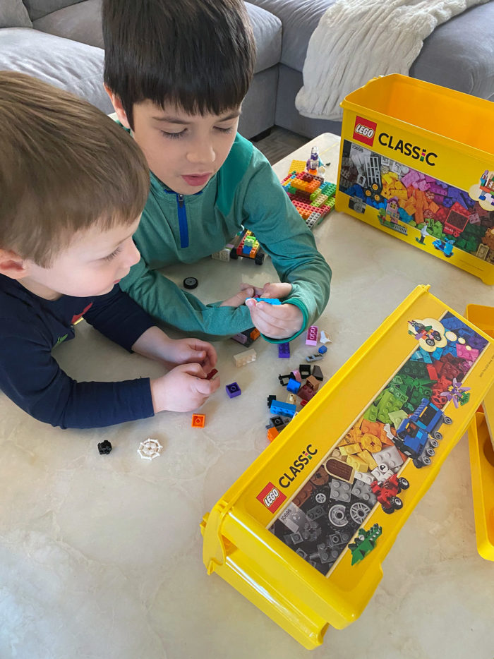 At Home Activities for Kids by popular Michigan lifestyle blog, The HSS Feed: image of two boys playing with Legos.
