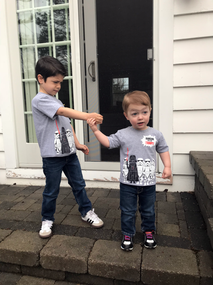 Star Wars Party Ideas for May the 4th (Star Wars Day!) | Star Wars Party Ideas by popular Michigan lifestyle blog, The HSS Feed: image of two young boys wearing matching Star Wars shirts.