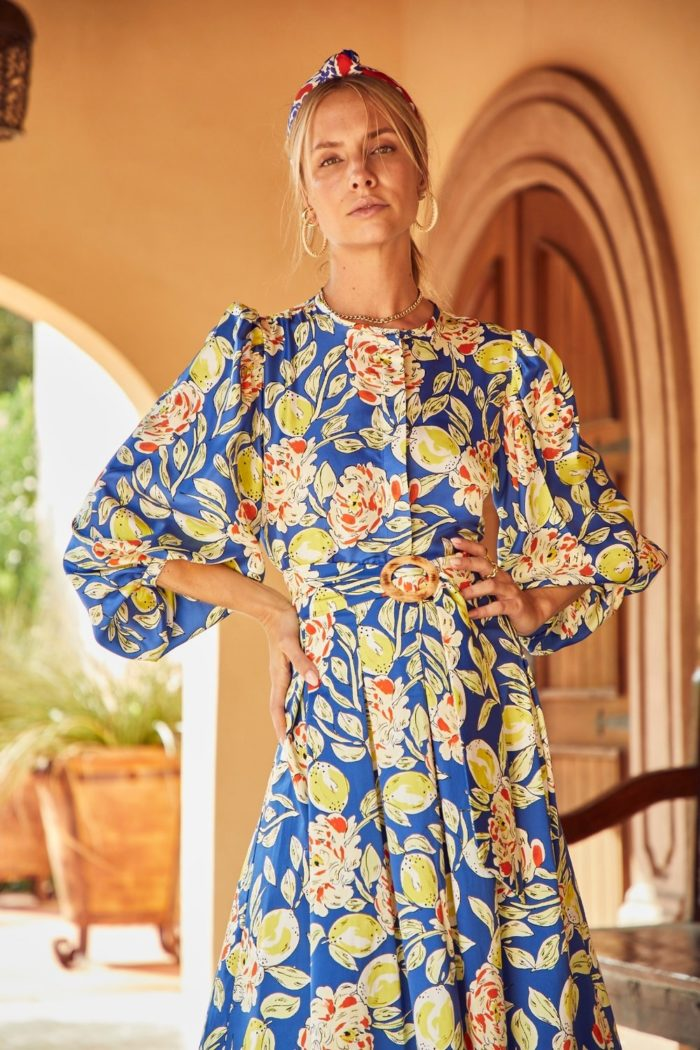 spring outfit ideas bright and colorful | Spring Outfit Ideas by popular Michigan fashion blog, The HSS Feed: image of a woman wearing a Hunter Bell lemon blossom print blouse, knot headband, and gold hoop earrings.