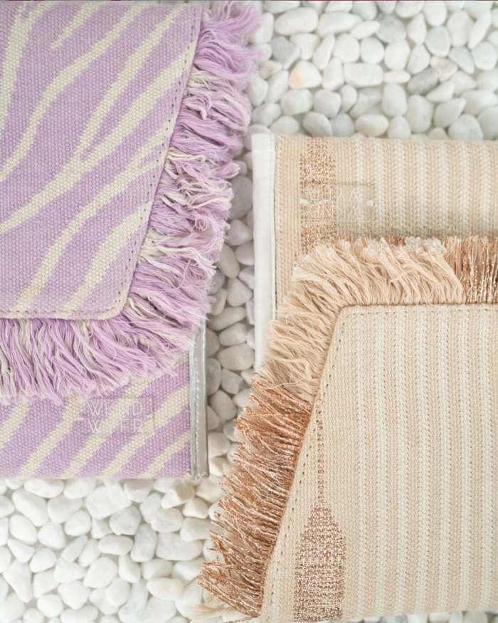 Small Businesses to Shop WKND WYFR | Small Businesses to Shop Now by popular Michigan life and style blog: image of purple and tan WKND WYFR clutches.