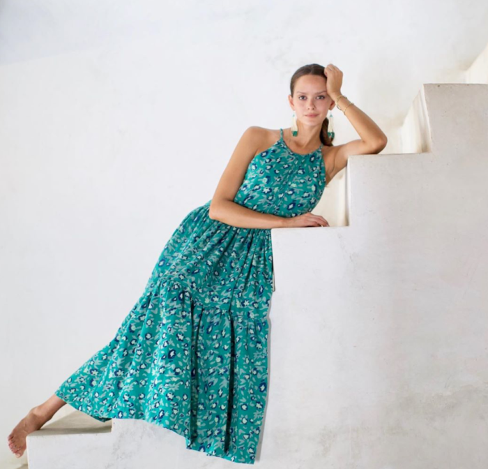 small businesses to shop MIRTH | Small Businesses to Shop Now by popular Michigan life and style blog: image of a woman wearing a Mirth green and blue tiered maxi dress.