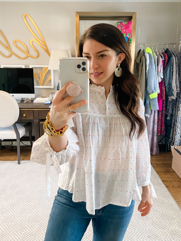 tops to wear to a zoom meeting Avenue Blouse | Tops to Wear to a Zoom Meeting by popular Michigan fashion blog, The HSS Feed: image of a woman wearing a Embroidered Candy Blouse from The Avenue.